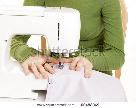 stock-photo-closeup-of-teen-girl-s-hands-using-a-sewing-machine-100488949