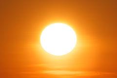 glaring-evening-sun-colorful-clear-orange-sky-30886315