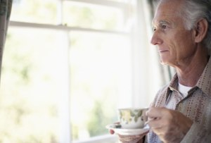 photolibrary_rf_photo_of_older_man_looking_out_window