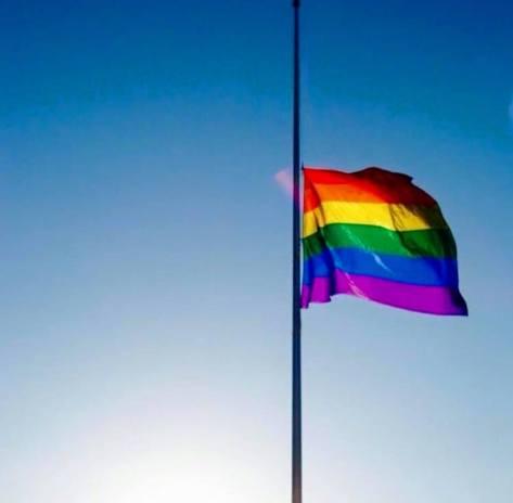 rainbow flag at half mast